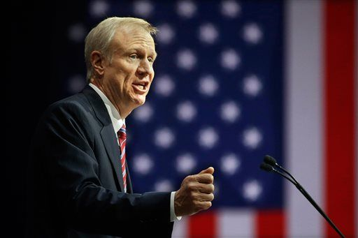 Bruce Rauner speaks to the crowd of supporters after taking the oath of office as Illinois' 42nd governor, Monday, Jan. 12, 2015, in Springfield Ill.