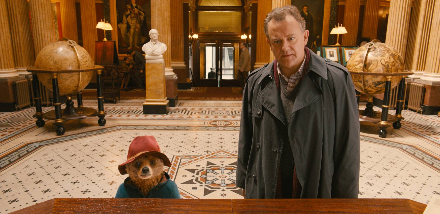 "Paddington the bear (Ben Whishaw) joins Henry (Hugh Bonneville) at his house during the charming kids' comedy ""Paddington."""