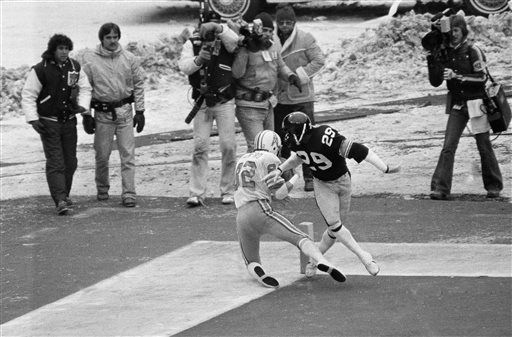FILE - In this Jan. 6, 1980, file photo, Houston Oilers' Mike Renfro (82) falls out of the endzone after catching a third quarter pass from Dan Pastorini as Pittsburgh Steelers Ron Johnson (29) defends during the AFC Championships game in Pittsburgh. The officials ruled it was not a touchdown. The Steelers won 27-13.