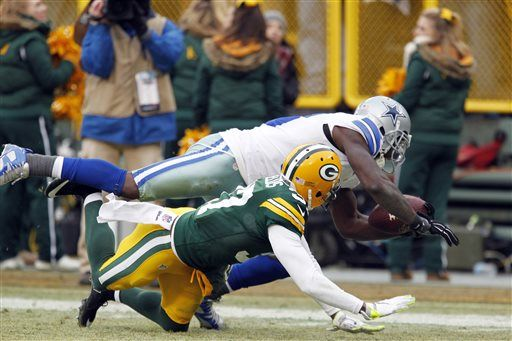 FILE - In this Jan. 11, 2015, file photo, Dallas Cowboys wide receiver Dez Bryant (88) grabs a pass against Green Bay Packers cornerback Sam Shields (37) during the second half of an NFL divisional playoff football game in Green Bay, Wisc. The play was reversed after review. The Packers won 26-21.