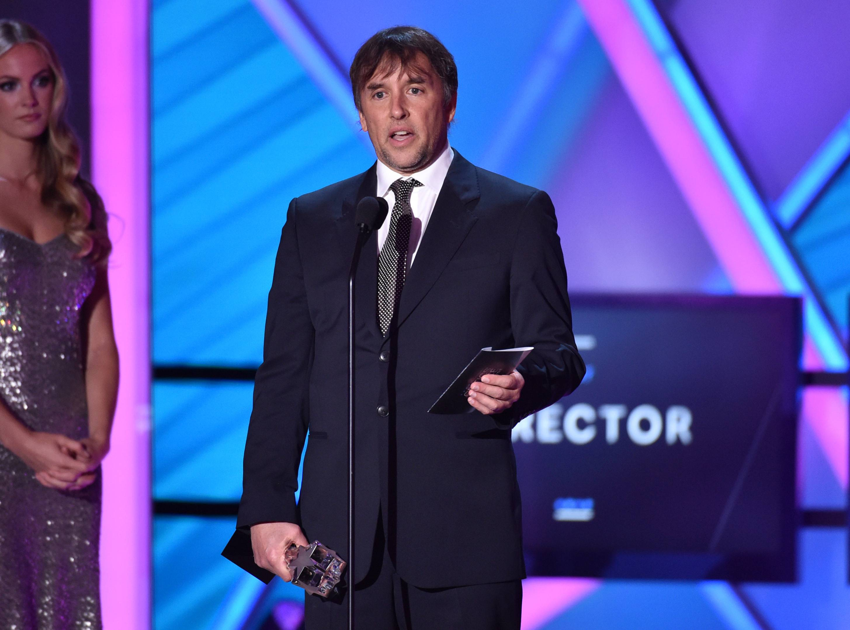 "Richard Linklater accepts the best director award for ""Boyhood"" at the 20th annual Critics' Choice Movie Awards at the Hollywood Palladium on Thursday in Los Angeles."