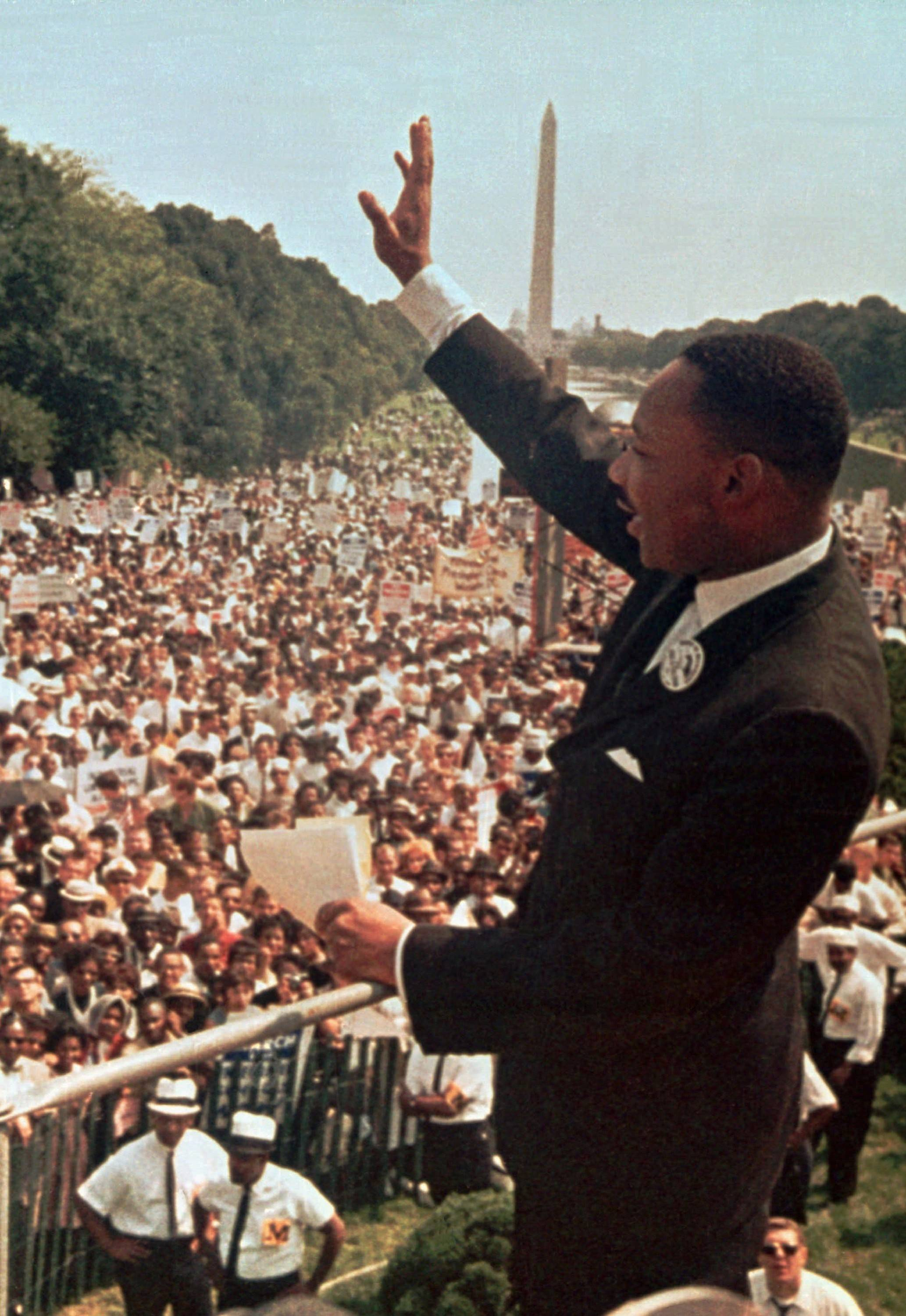"The Rev. Martin Luther King Jr. acknowledges the crowd at the Lincoln Memorial for his ""I Have a Dream"" speech during the march on Washington, D.C., on Aug. 28, 1963."