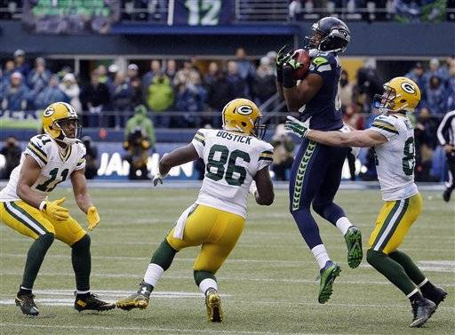 Seattle Seahawks' Chris Matthews recovers an on side kick during the second half of the NFL football NFC Championship game against the Green Bay Packers Sunday, Jan. 18, 2015, in Seattle.