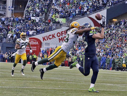 Seattle Seahawks' Jermaine Kearse catches the game winning touchdown pass against Green Bay Packers' Tramon Williams during overtime of the NFL football NFC Championship game, Sunday, Jan. 18, 2015, in Seattle. The Seahawks won 28-22 to advance to Super Bowl XLIX.