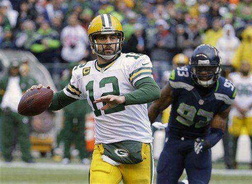 Green Bay Packers' Aaron Rodgers throws during the second half of the NFL football NFC Championship game against the Seattle Seahawks Sunday, Jan. 18, 2015, in Seattle.
