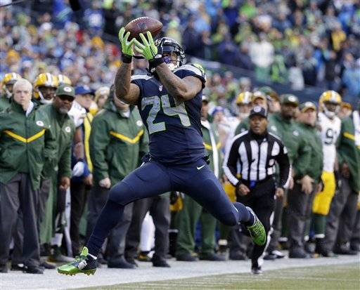 Seattle Seahawks' Marshawn Lynch catches a pass during the second half of the NFL football NFC Championship game against the Green Bay Packers Sunday, Jan. 18, 2015, in Seattle.