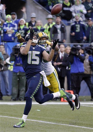 Seattle Seahawks' Jermaine Kearse catches the game-winning touchdown pass in front of Green Bay Packers' Tramon Williams during overtime of the NFL football NFC Championship game Sunday, Jan. 18, 2015, in Seattle. The Seahawks won 28-22 to advance to Super Bowl XLIX.