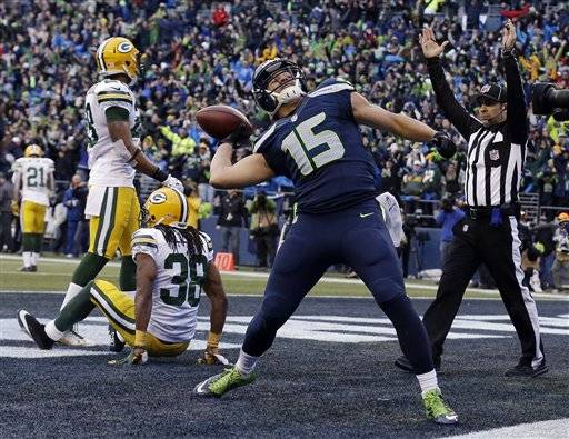 Seattle Seahawks' Jermaine Kearse celebrates after catching the game-winning touchdown during overtime of the NFL football NFC Championship game against the Green Bay Packers Sunday, Jan. 18, 2015, in Seattle. The Seahawks won 28-22 to advance to Super Bowl XLIX.