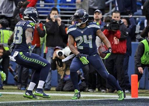 Seattle Seahawks' Marshawn Lynch (24) celebrates his touchdown run during the second half of the NFL football NFC Championship game against the Green Bay Packers Sunday, Jan. 18, 2015, in Seattle.