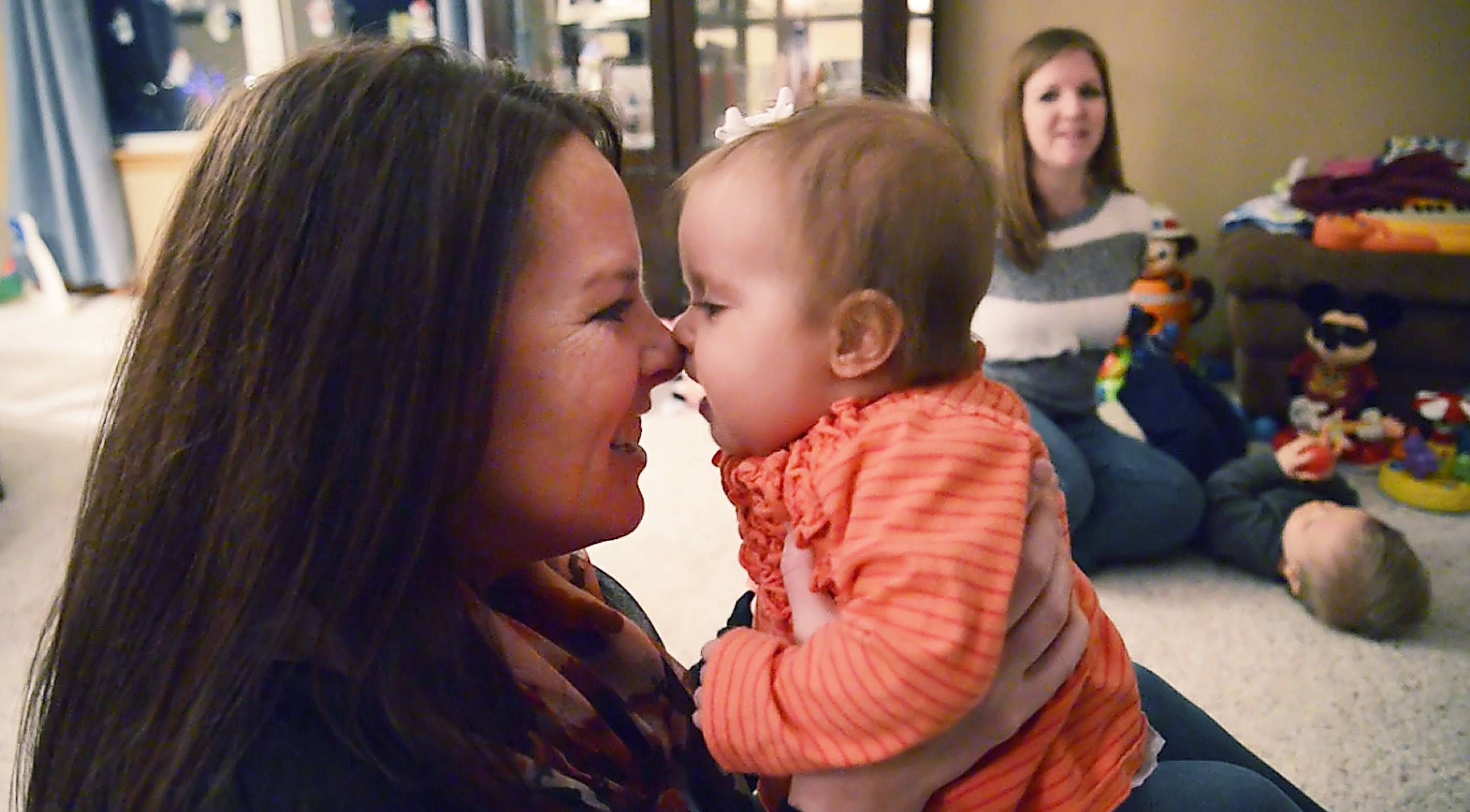 Holly Schlesser goes nose to nose with Madison Casey, to whom she donated her liver in November. Madison is the daughter of Schlesser's best friend, Tanya Casey of South Elgin, who plays with Madison's twin brother in the background in their South Elgin home.