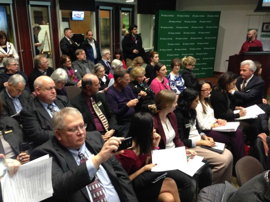 An audience waits before College of DuPage board members were scheduled to vote tonight on whether to end President Robert Breuder's tenure early with a roughly $762,000 buyout package.