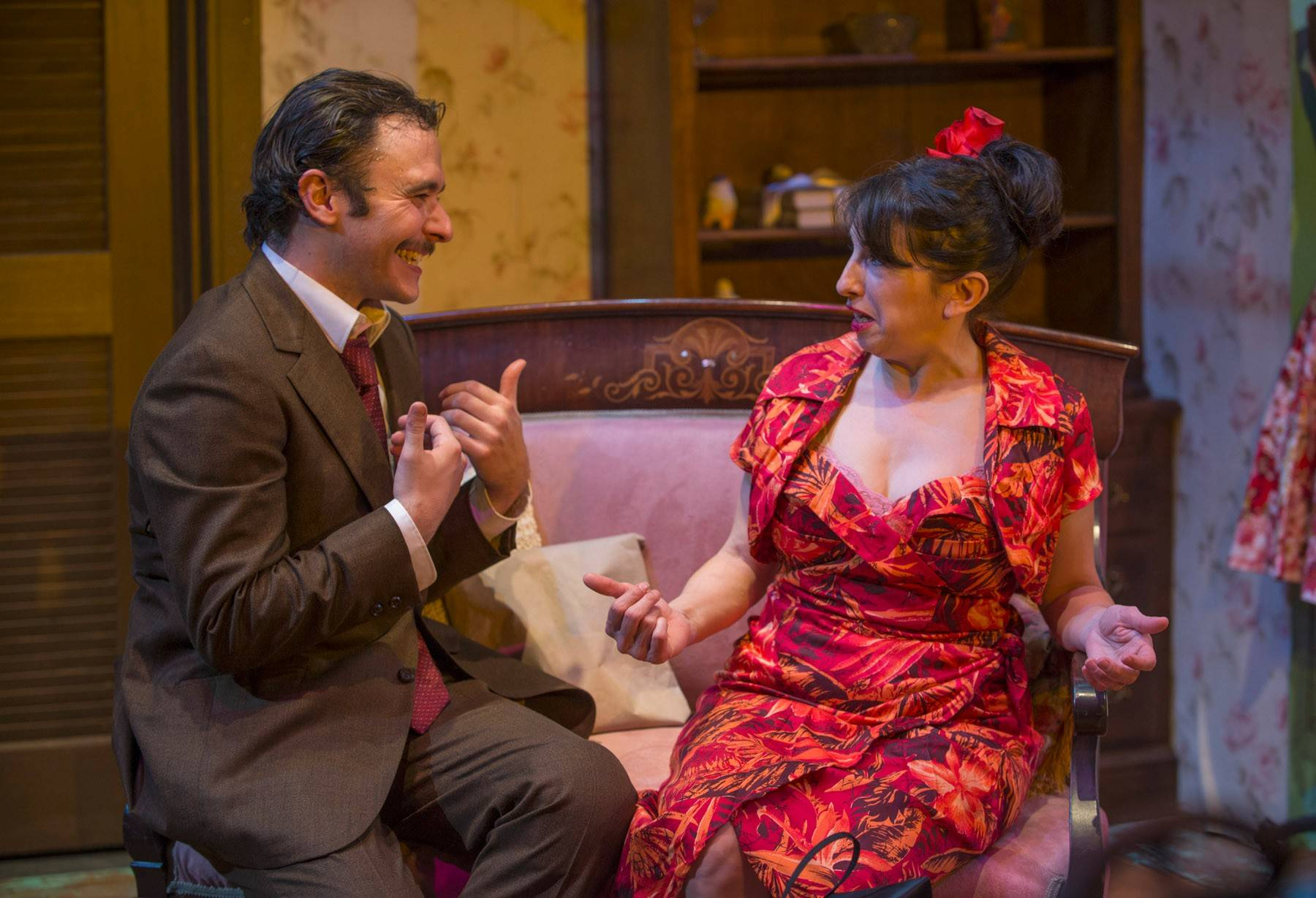 "Eileen Niccolai plays Serafina Delle Rose, a lonely widow taking tentative steps toward romance with an affable young truck driver Alvaro Mangiacavallo (Nic Grelli) in Shattered Globe Theatre's revival of Tennessee Williams'' ""The Rose Tattoo."""