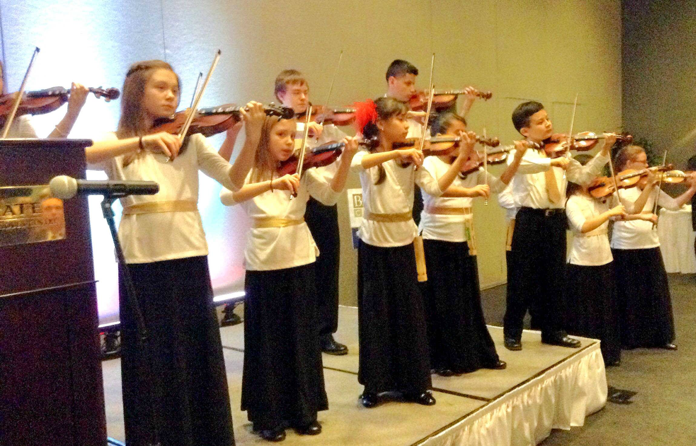 Members of 4 Strings Attached, a McHenry-based nonprofit music group, perform Thursday night during the Barrington Area Chamber of Commerce gala in Hoffman Estates.