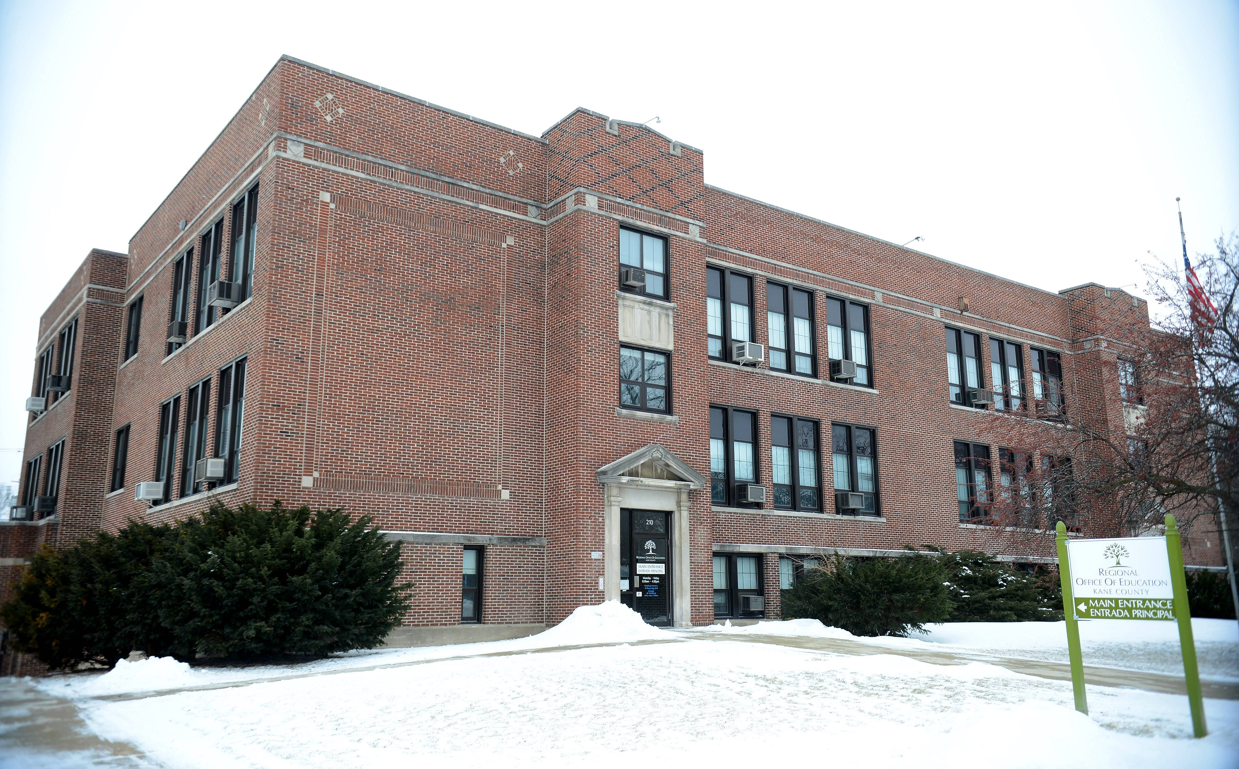 The Geneva Library board voted Thursday to buy the former Sixth Street School from Kane County. It intends to raze the building and consider it for a new library.