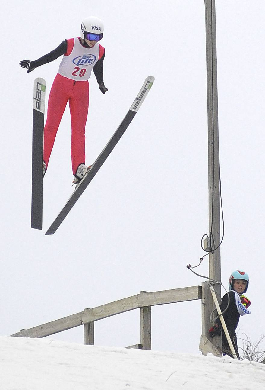 Norge Ski Club member Cara Larson, 14, of Barrington competes on the 70-meter hill in the K70 Junior category Saturday at the Norge 110th Annual International Ski Jump Tournament in Fox River Grove.