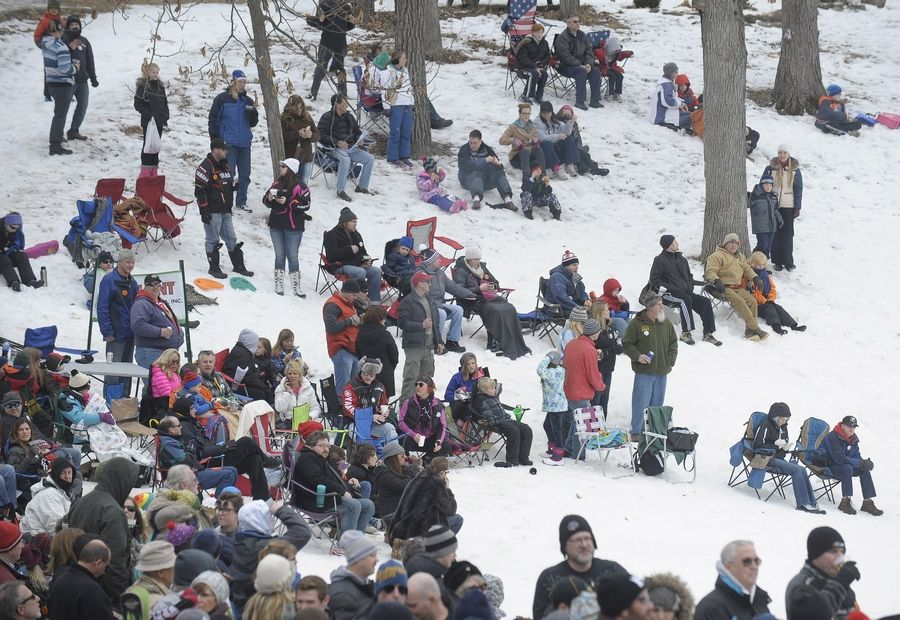 Spectators watch the Norge 110th Annual International Ski Jump Tournament on Saturday in Fox River Grove.