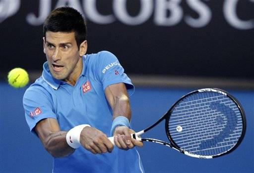 Novak Djokovic of Serbia makes a backhand return to Fernando Verdasco of  Spain during their third 0b015876b64a7