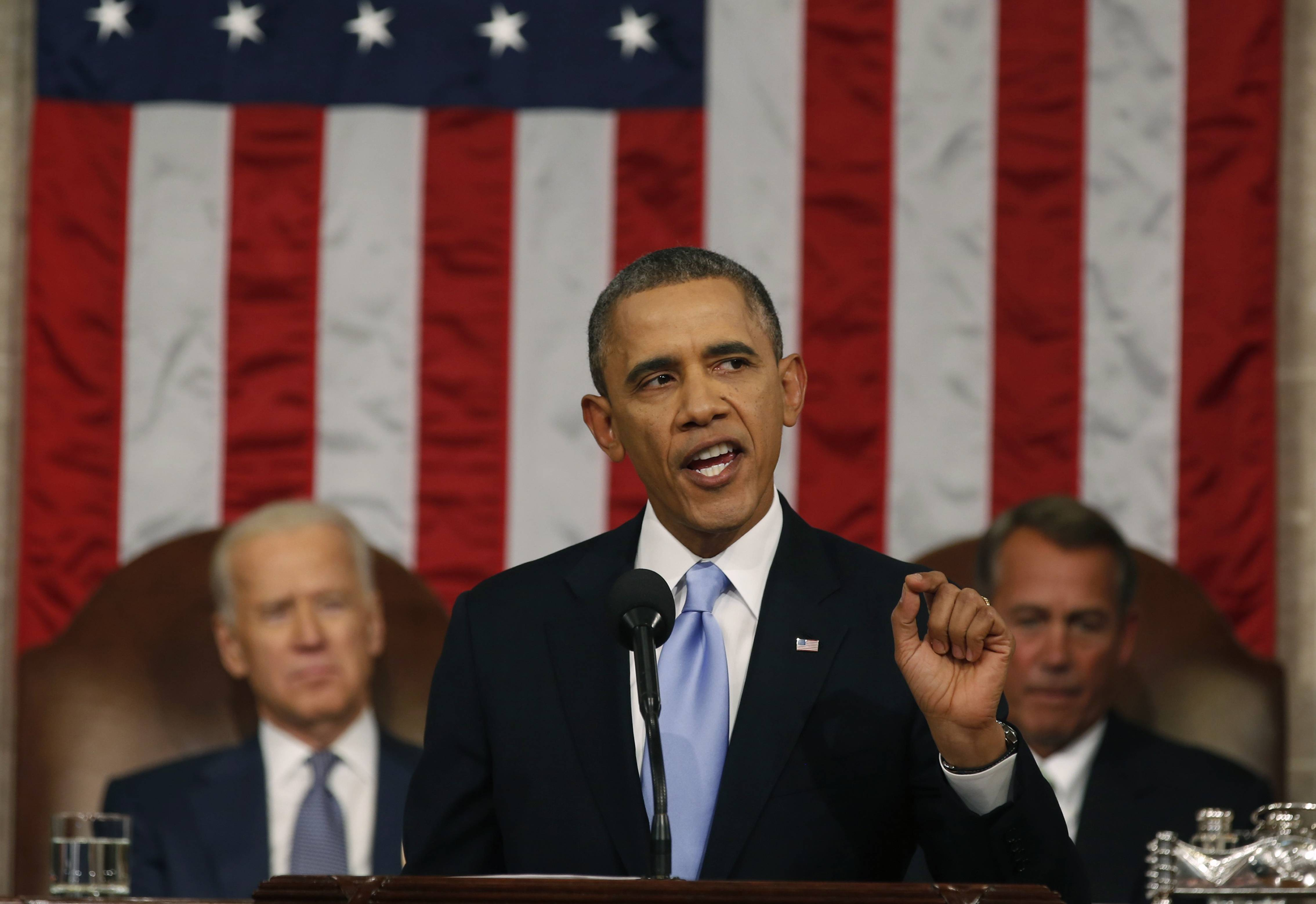 President Barack Obama delivers the State of Union address Tuesday before a joint session of Congress in the House chamber on Capitol Hill in Washington as Vice President Joe Biden and House Speaker John Boehner of Ohio listen.