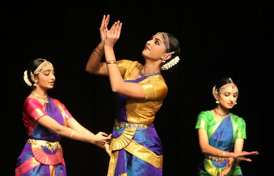 "Dancers in colorful outfits perform Sunday during ""Timeless Tales: A Performance by Natya Dance Theatre"" at Stevenson High School's auditorium in Lincolnshire. The performance featured the South Indian dance form called Bharata Natyam, and was sponsored by the Vernon Area Public Library and the Stevenson High School Foundation."