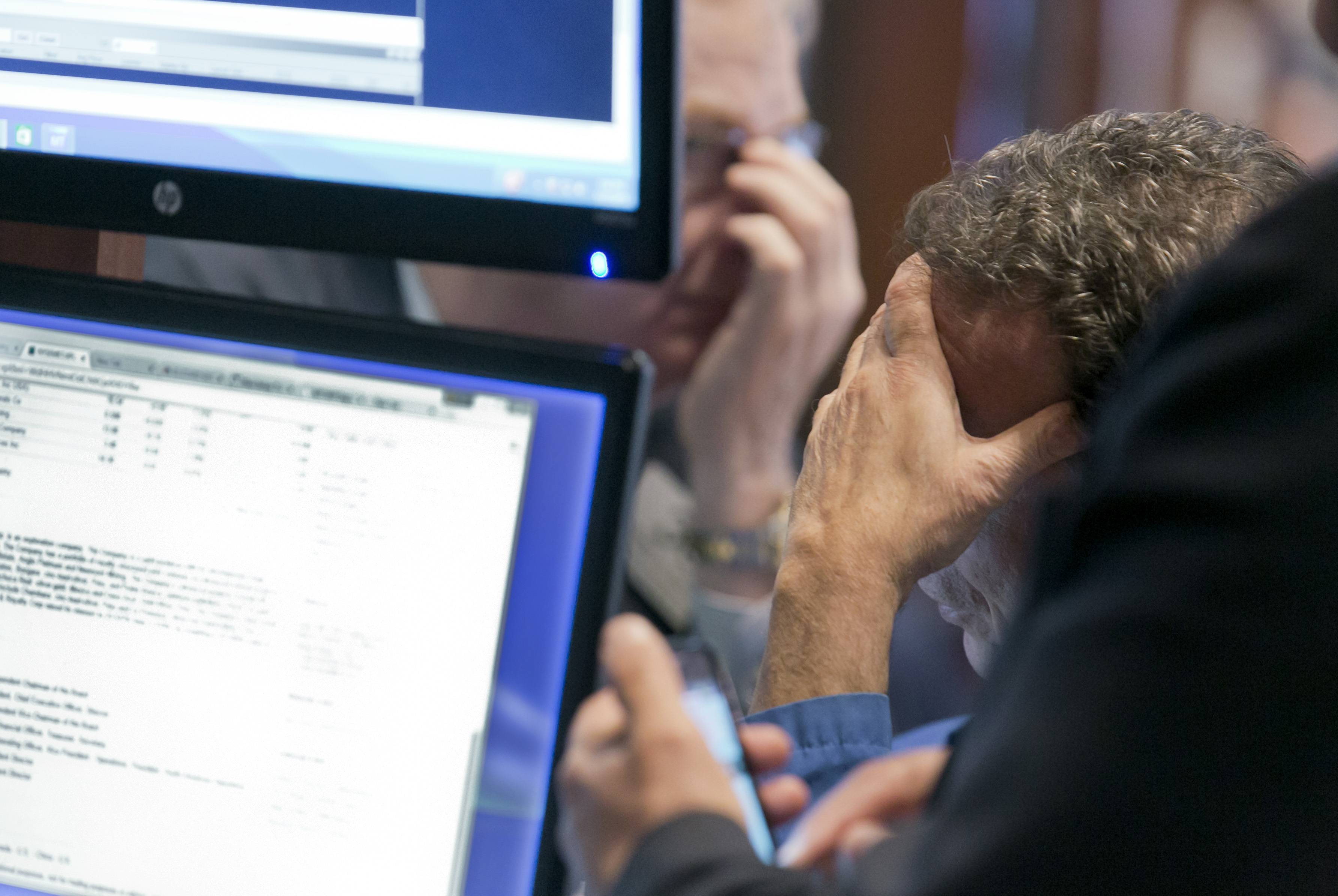 Traders work Tuesday on the floor of the New York Stock Exchange. U.S. stocks were weighed down by disappointing forecasts. Even companies that boasted strong quarterly results, such as American Airlines Group, which recorded record quarterly profit, also delivered cautionary notes.