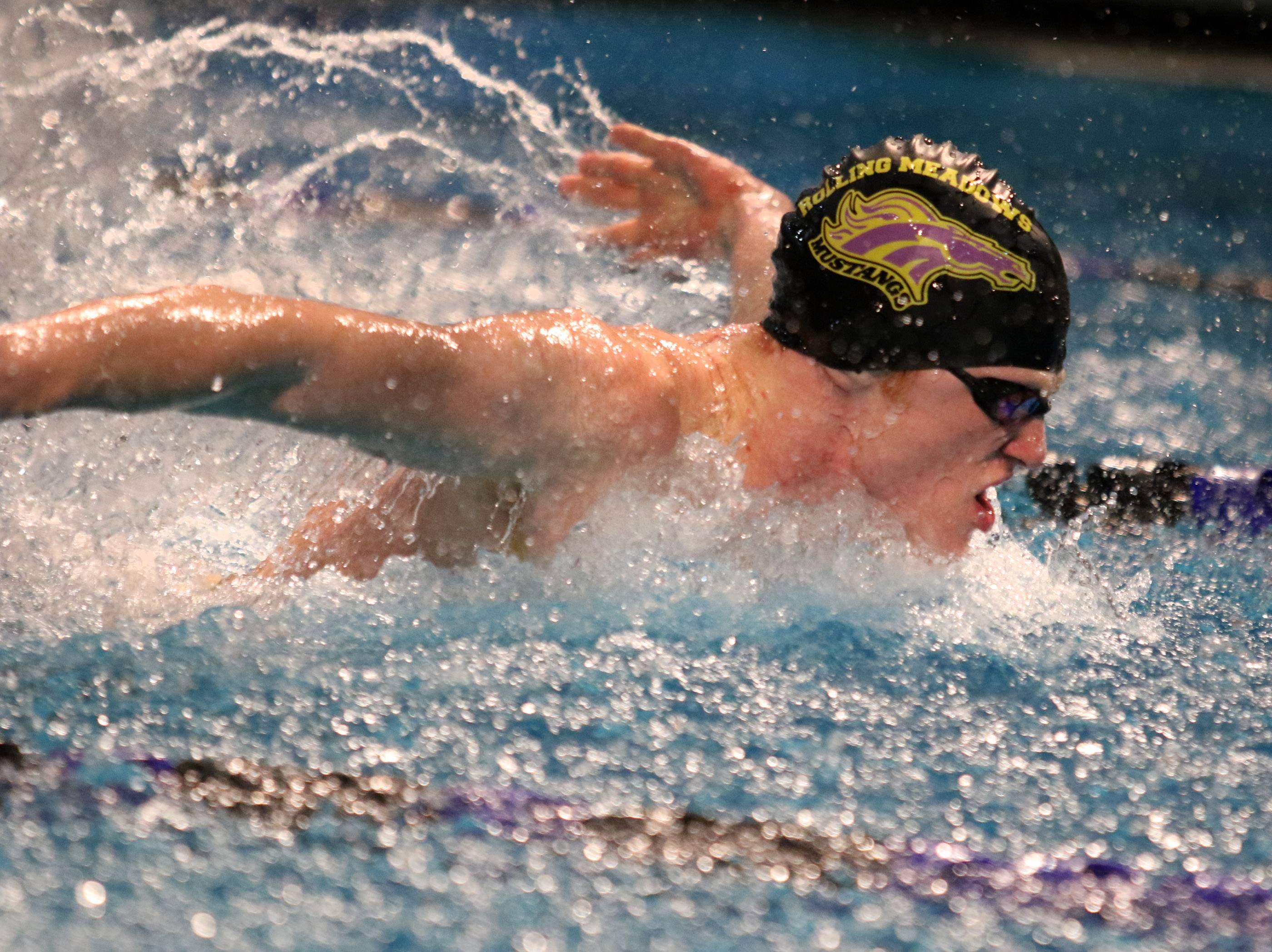 Rolling Meadows' Jake Barson wins the 200-yard IM with a time of 1:49.15 at a boys swim meet on Friday in Wheeling.