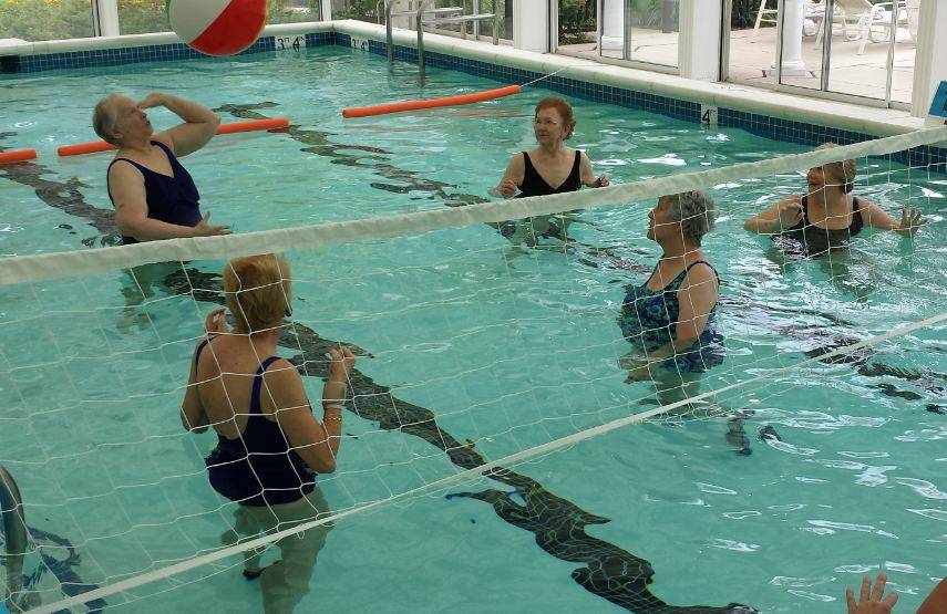 Residents at Sedgebrook senior living community take part in a water volleyball game.