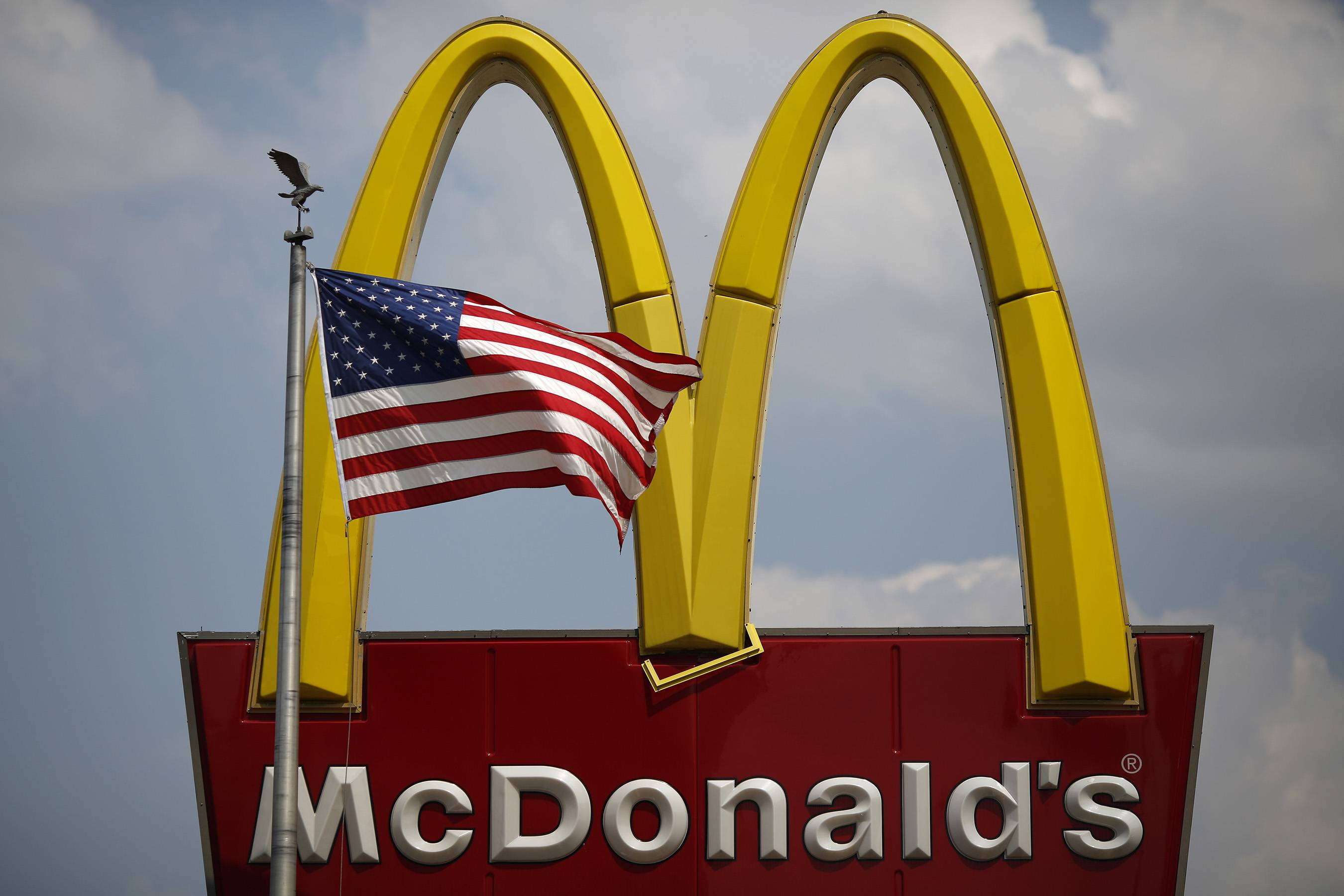 BLOOMBERG FILE PHOTO McDonald's announced Thursday that it will lay off more than 100 people who work at the Oak Brook headquarters or an office in Warrenville.