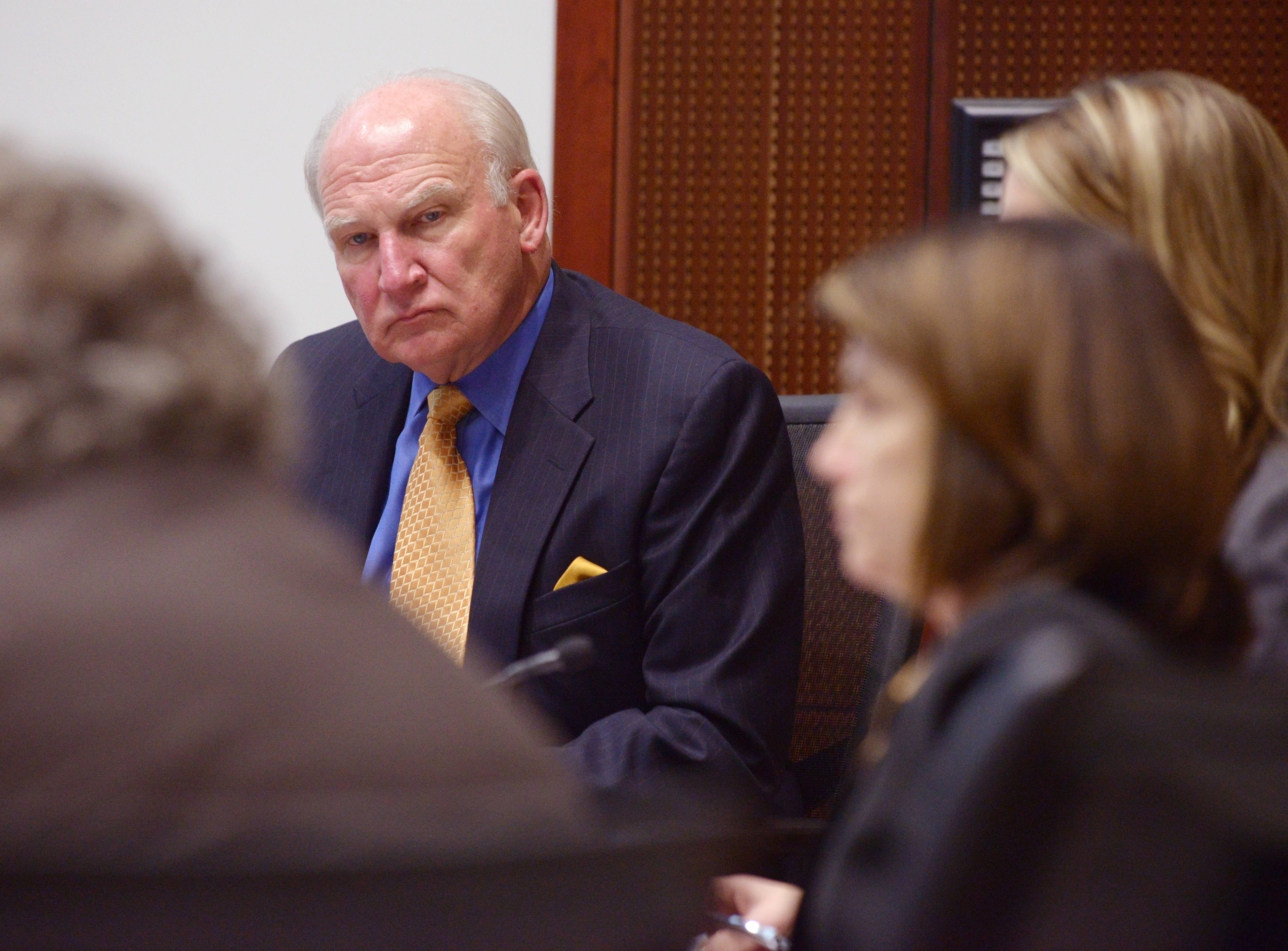 Mark Black/mblack@dailyherald.com College of DuPage President Robert Breuder listens as the COD board prepares to vote on his $762,868 severance package Wednesday.