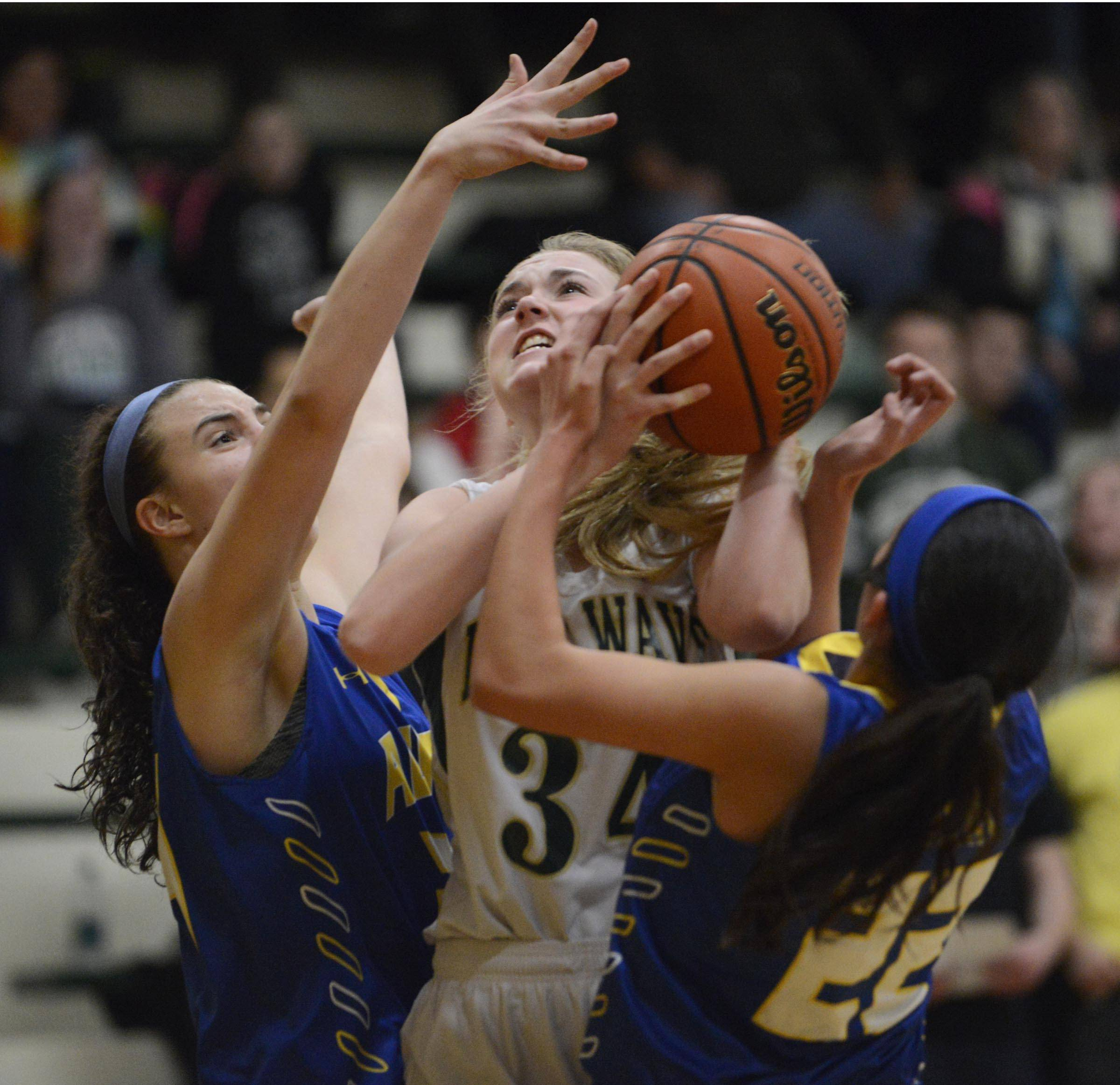 St. Edward's Cece Rapp is double-teamed by Aurora Central Catholic's Sabrina Ganofsky and Veronica Lavia, right.