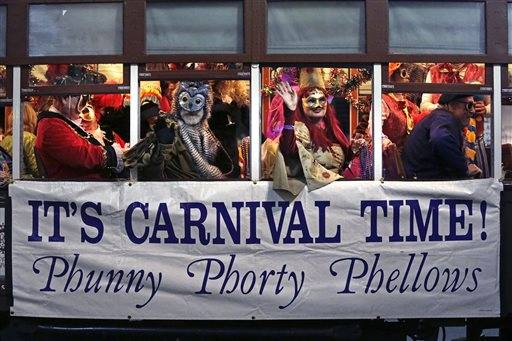 FILE - This Jan. 6, 2015 photo shows members of the Phunny Phorty Phellows, celebrating aboard a streetcar in New Orleans. King's Day is a tradition marking the 12th night after Christmas and the official start of the Mardi season. Carnival is celebrated along the Gulf Coast with parties, balls and parades culminating on Mardi Gras, or Fat Tuesday, a final day of celebration before Lent. It is a major tourist draw in New Orleans. Mardi Gras falls on Feb. 17 this year. (AP Photo/Gerald Herbert, File)