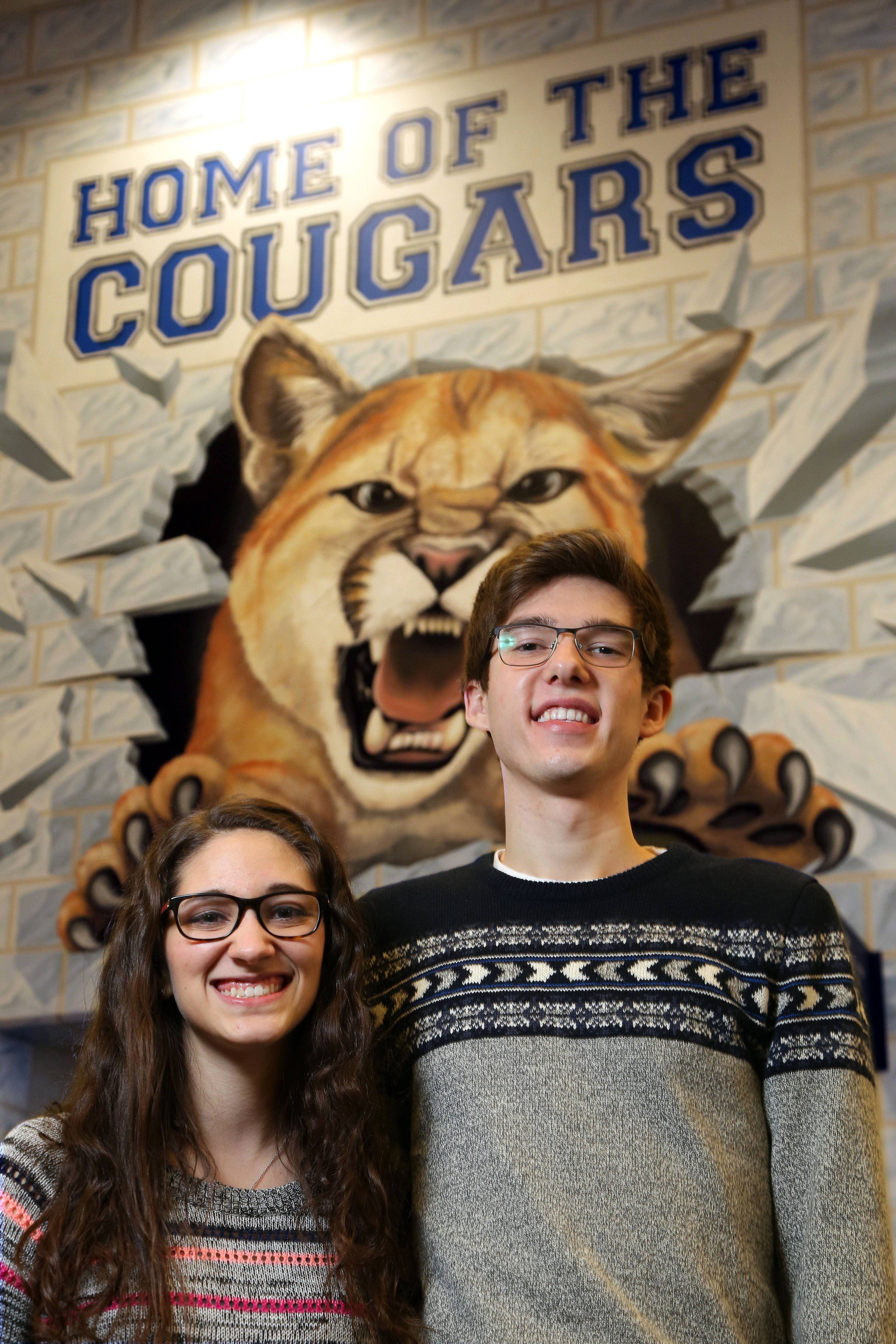 Vernon Hills High School students Serena Panos, 16, left, and Jack Brandl, 18, participated in a service project called the VING project. For this project, both students submitted a one-minute video explaining why a person who they know deserves to receive $1,000.