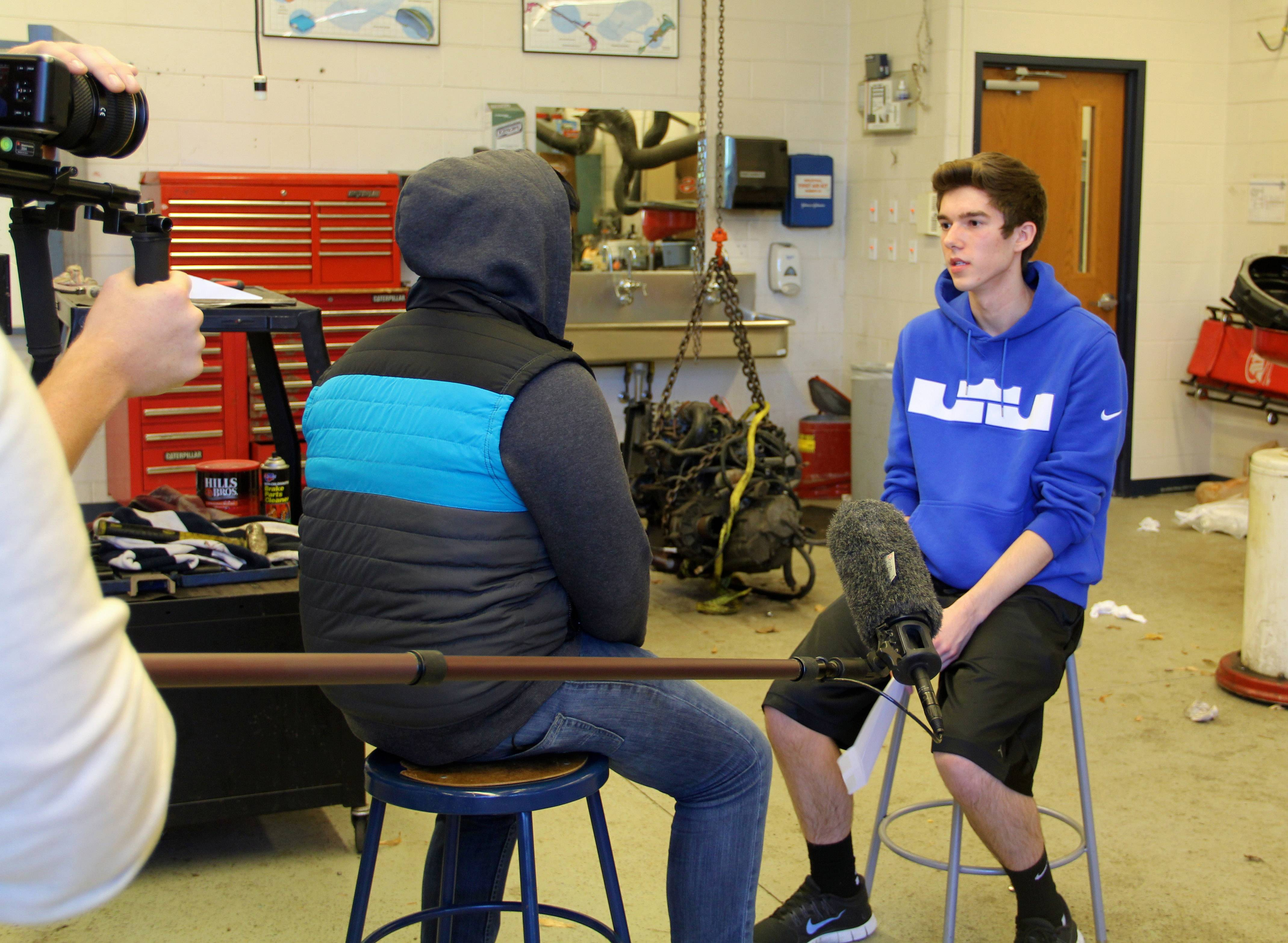 VING Project participant Jack Brandl, right, 18, breaks the news to fellow student Octavio inside the Vernon Hills High School shop room that Octavio is the recipient of a $1,000 gift.