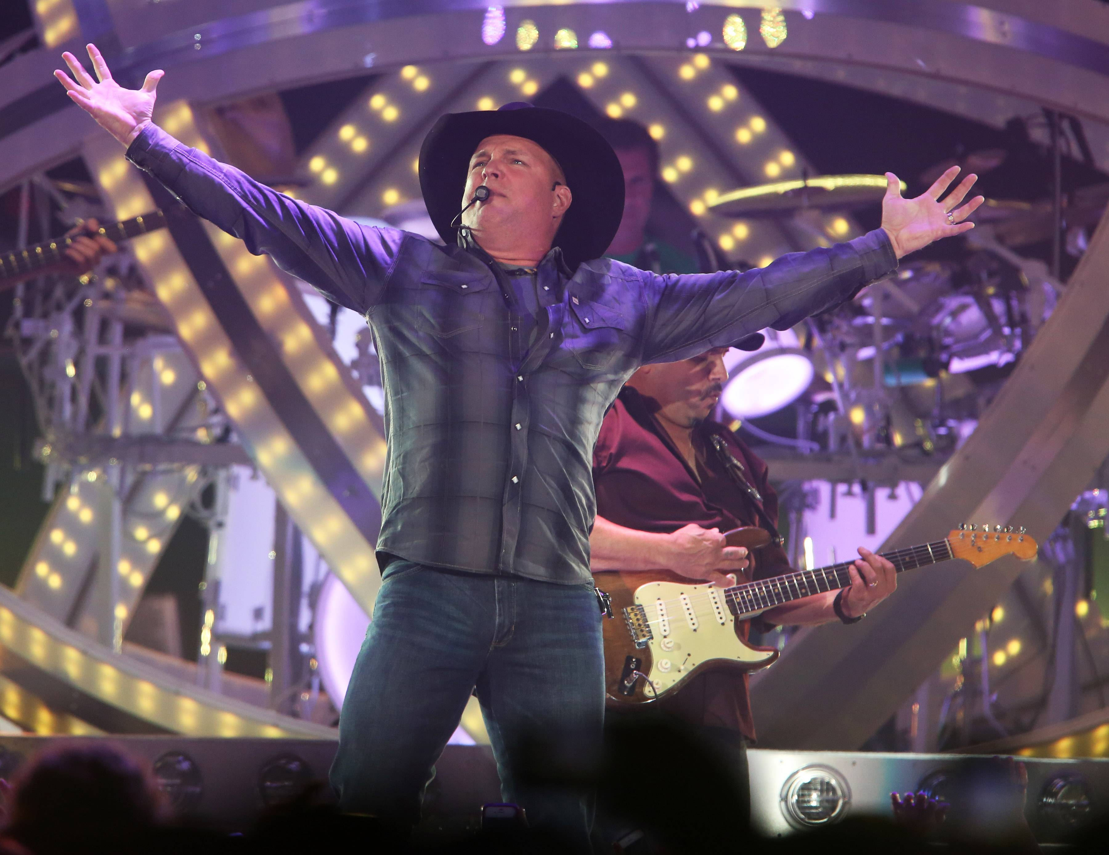 Country music star Garth Brooks performs at Allstate Arena in Rosemont last year. Rosemont officials argue that some of the details of the village's bid to bring Brooks to the arena need to be kept secret for competitive reasons.