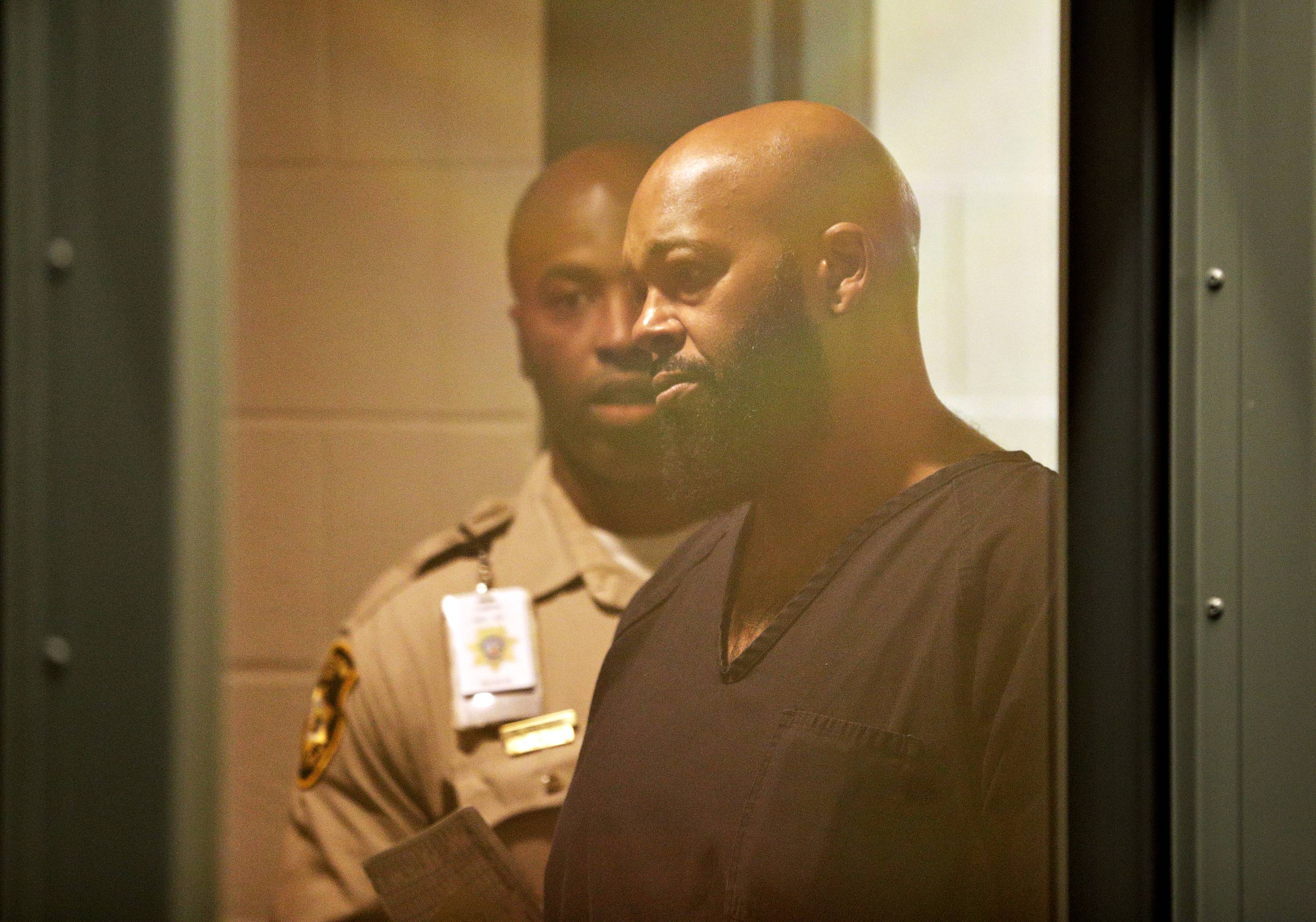 "In this Oct. 30, 2014, photo, rap music mogul Marion ""Suge"" Knight appears in court on a traffic warrant in Las Vegas following his arrest as a fugitive in a California robbery case. A lawyer for Knight says the Death Row Records founder was at the wheel of a car that struck two men, killing one, in a Los Angeles suburb. The accident in Compton occurred shortly before 3 p.m. Thursday, Jan. 29."