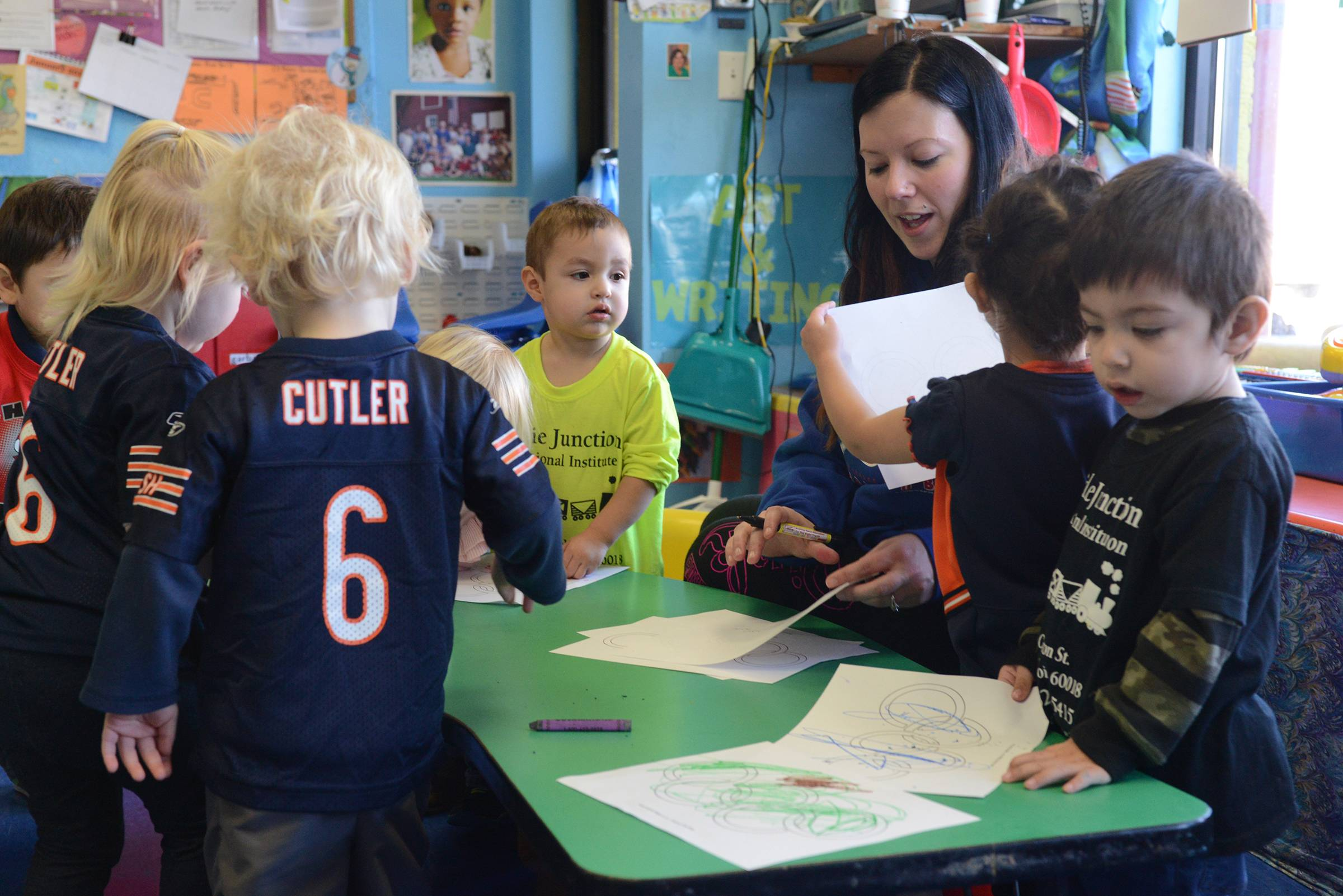 Kristen Lauretta of Niles works with 2-year-olds at Kiddie Junction Education Institute in Des Plaines on Friday. State subsidies for low-income families run out Monday, and many parents no longer will be able to afford day care.