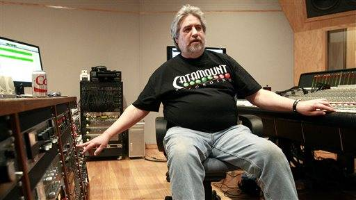 FOR RELEASE SATURDAY, JANUARY 31, 2015, AT 12:01 A.M. CST. - In this photo taken on Friday, Jan. 23, 2015, Catamount producer and chief engineer Tom Tatman explains the engineering side of music at Catamount Recording Studios, in Cedar Falls, Iowa. Catamount has been chosen for the Iowa Rock and Roll Music Association's Hall of Fame.