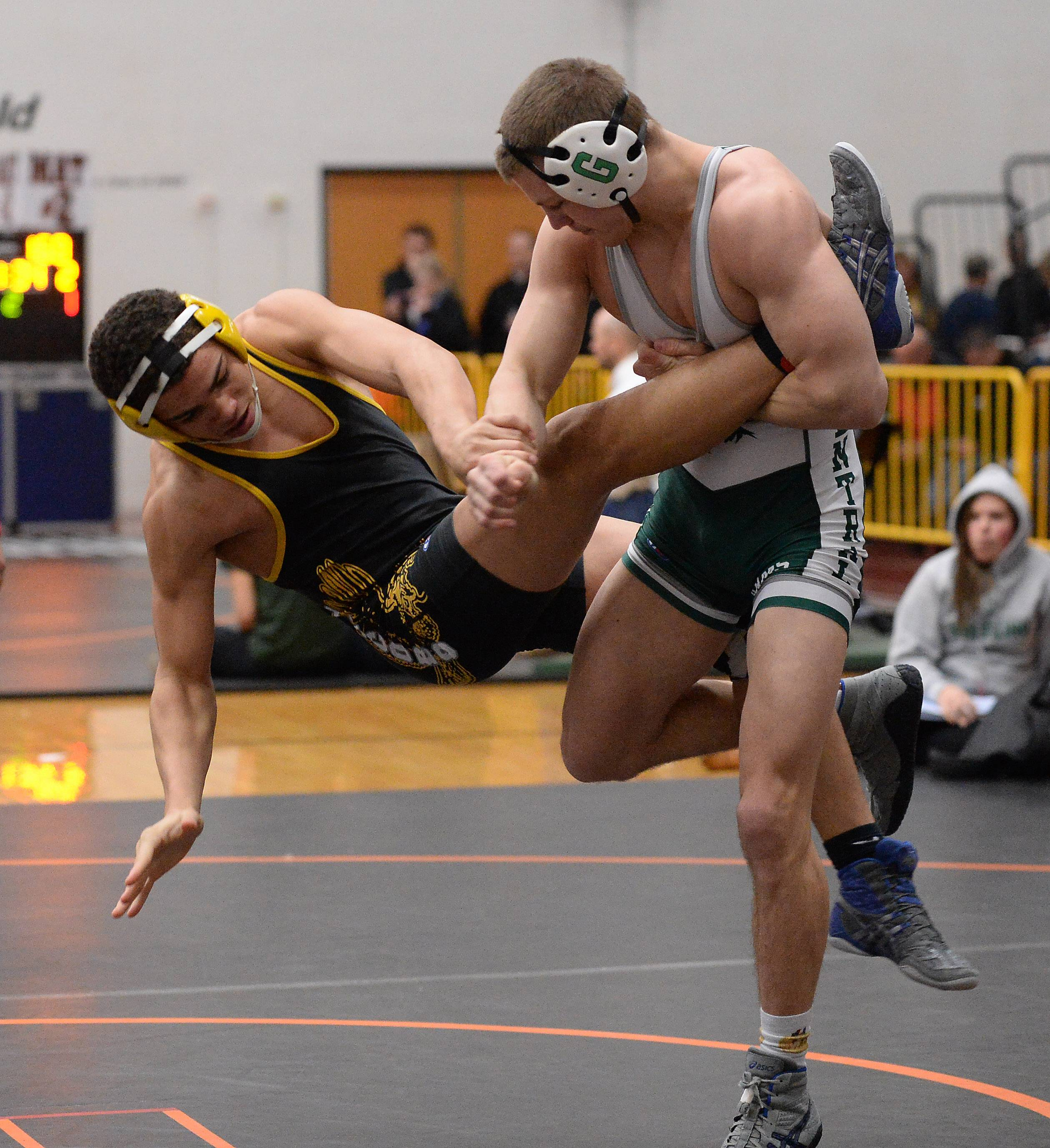 Grayslake Central's Jon Makey overpowers Loren Strickland of Jacobs in the 160 weight class for the win at the 2015 Fox Valley Conference Wrestling Tournament at McHenry High School.