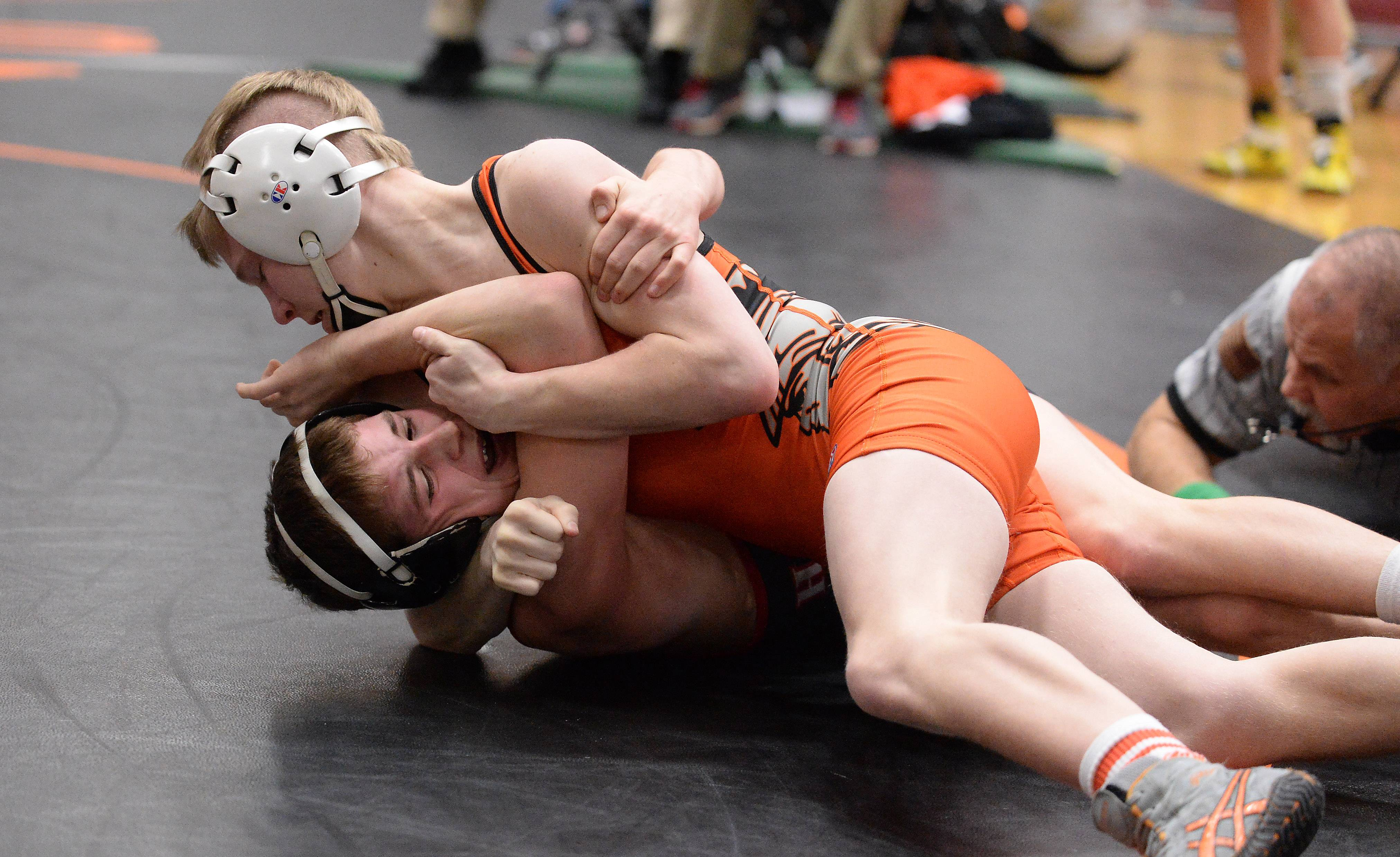 Ian Mullen of McHenry overpowers Zach Spencer of Huntley in the 106 weight class for the pin and the win at the 2015 Fox Valley Conference Wrestling Tournament at McHenry High School.