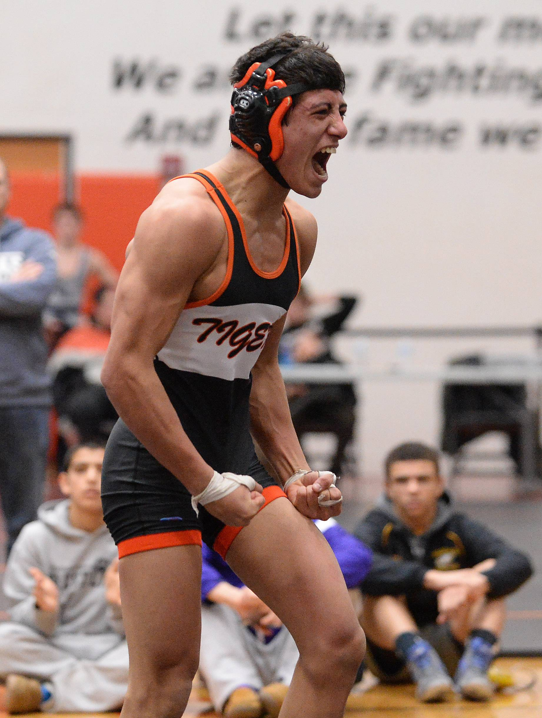 Mike Peterson of Crystal Lake Central is pumped after overpowering John Cullen of Cary Grove in the 138 weight class for the win at the 2015 Fox Valley Conference Wrestling Tournament at McHenry High School.