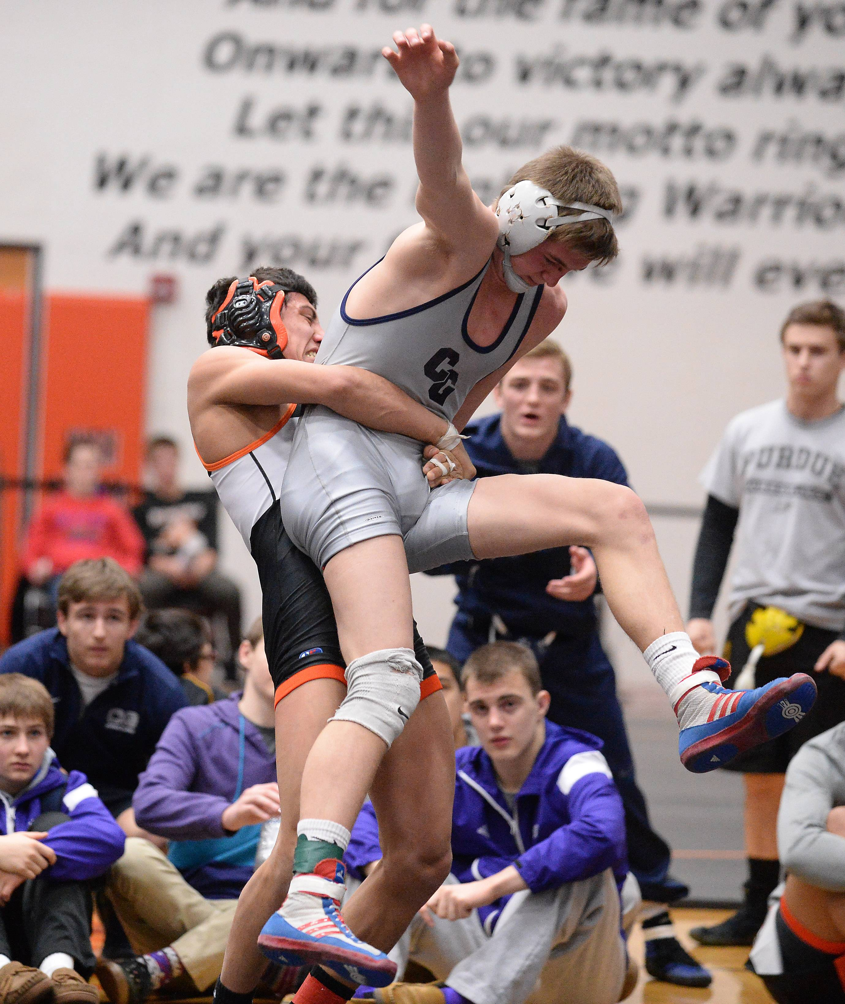 Mike Peterson of Crystal Lake Central overpowers John Cullen of Cary Grove in the 138 weight class for the win at the 2015 Fox Valley Conference Wrestling Tournament at McHenry High School.