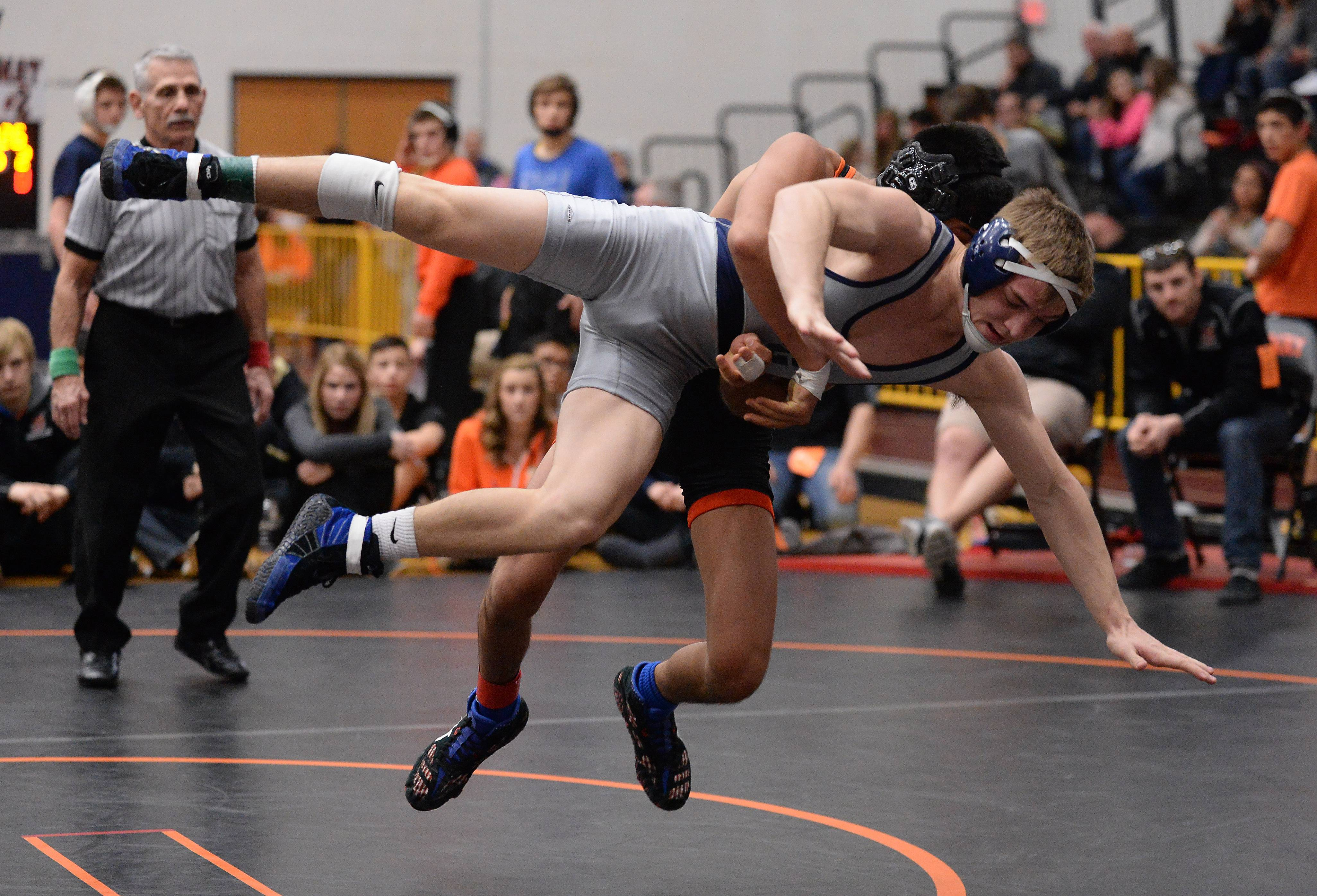 Michael Cullen of Cary Grove is tossed to the ground by Lenny Peterson of Crystal Lake Central but recovers for the eventual win in the 126 weight class for the win at the 2015 Fox Valley Conference Wrestling Tournament at McHenry High School.