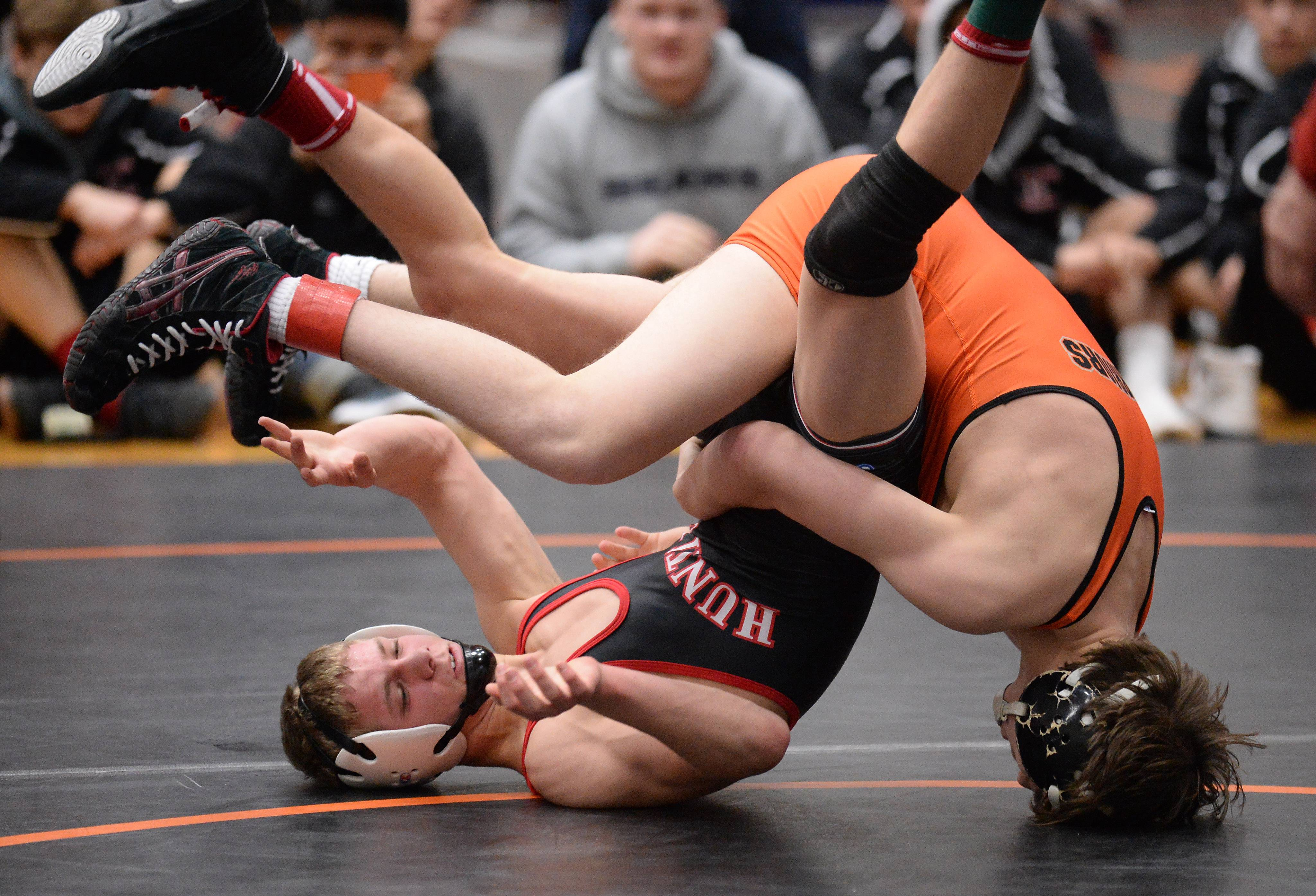 Britches Sikula of McHenry overpowers Josh Stenger of Huntley in the 113 weight class for the win at the 2015 Fox Valley Conference Wrestling Tournament at McHenry High School.
