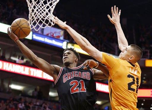 Phoenix Suns' Alex Len, right, defends the basket as Chicago Bulls' Jimmy Butler goes up for a shot during the first half of an NBA basketball game Friday, Jan. 30, 2015, in Phoenix. (AP Photo/Ross D. Franklin)