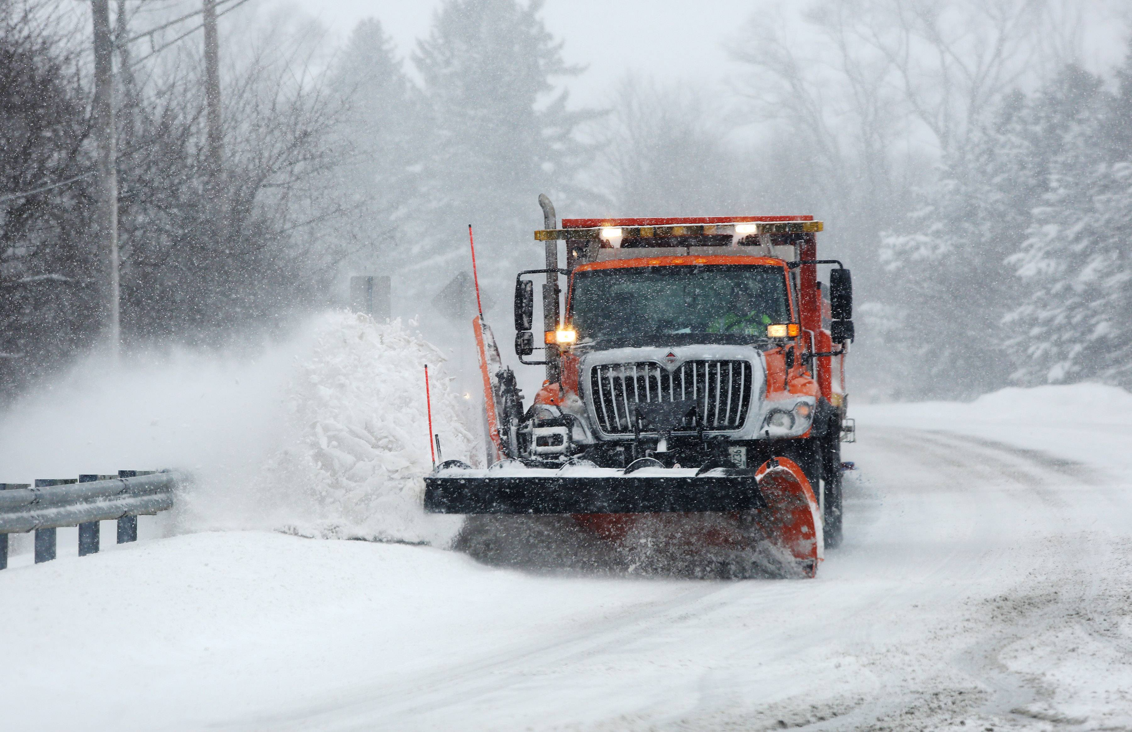 A Village of Wauconda Public Works plow clears Main Street during a snowstorm that hit Lake County throughout the day Sunday. Snow plows were having a hard time keeping the roads clear and many places experienced whiteout conditions.
