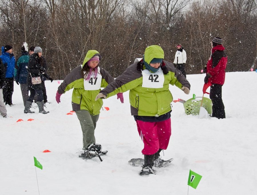 Ruth Moyer, No. 42, is participating in the 100-meter snowshoeing race at the Special Olympics Illinois' Winter Games in Galena. She is a resident of Lambs Farm in Green Oaks.