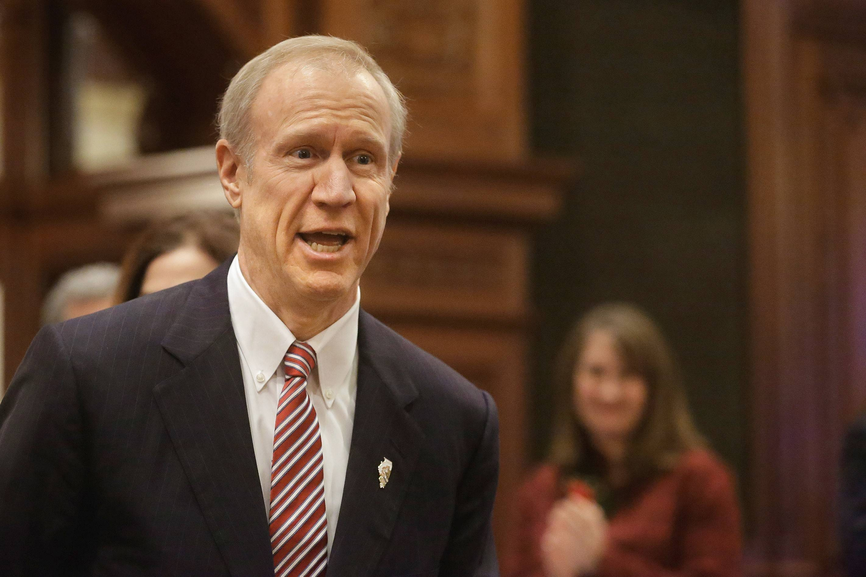 Illinois Gov. Bruce Rauner acknowledges applause before delivering his State of the State address to a joint session of the General Assembly, Wednesday at the Capitol in Springfield.