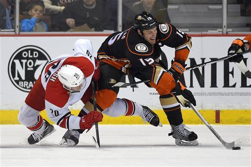 Carolina Hurricanes center Riley Nash, left, and Anaheim Ducks center Ryan Getzlaf competes for the puck after a face-off during the first period of an NHL hockey game, Tuesday, Feb. 3, 2015, in Anaheim, Calif.