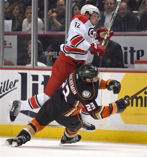 Carolina Hurricanes center Eric Staal, top, and Anaheim Ducks defenseman Francois Beauchemin collide during the first period of an NHL hockey game, Tuesday, Feb. 3, 2015, in Anaheim, Calif.
