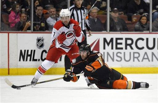 Anaheim Ducks right wing Kyle Palmieri, right, passes the puck under pressure from Carolina Hurricanes defenseman Ryan Murphy during the first period of an NHL hockey game, Tuesday, Feb. 3, 2015, in Anaheim, Calif.