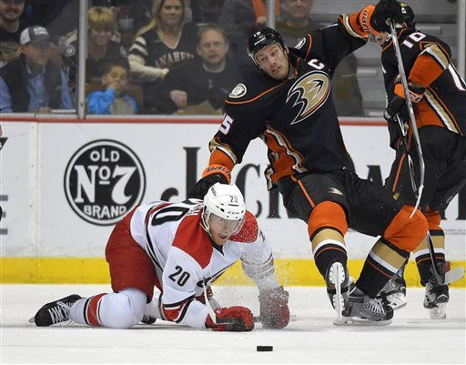 Carolina Hurricanes center Riley Nash, left, and Anaheim Ducks center Ryan Getzlaf, center, vie for the puck along with Anaheim right wing Corey Perry during the first period of an NHL hockey game, Tuesday, Feb. 3, 2015, in Anaheim, Calif.